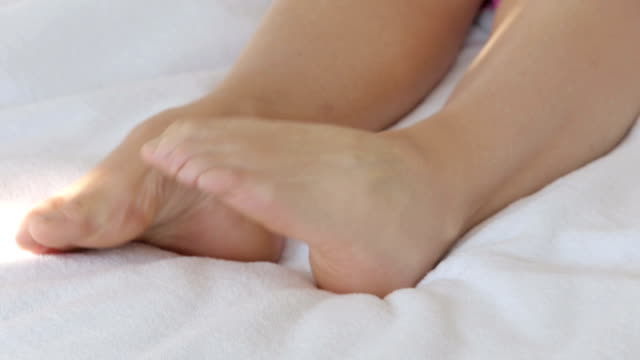 closeup of womans feet in bed video