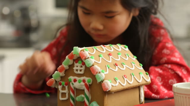 Closeup of young girl decorating gingerbread video