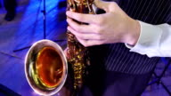 Close-up on fingers pressing the keys of the saxophone video
