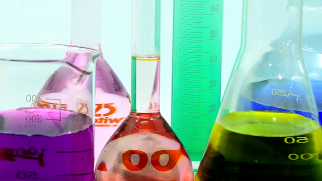 close-up panning : chemicals in different glassware video