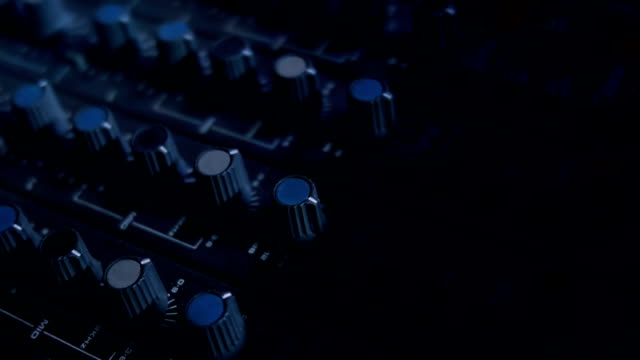 Close-up panning shot of EQ Knobs on a mixing console desk video