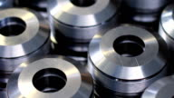 Closeup pattern of shiny circular precision stainless steel industrial machine parts video
