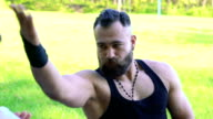 Closeup performance of Wing Chun by master on forest background. Slowly video
