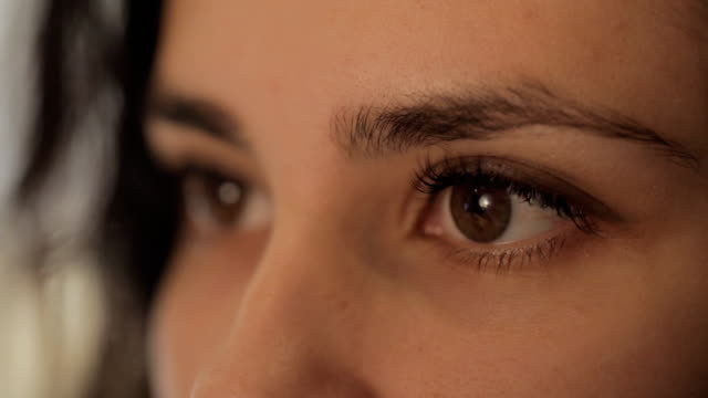 close-up portrait of a beautiful girl eye masters for the production of jewelry, works with blanks video