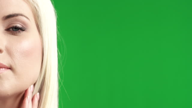 Close-up portrait of a young woman on green-screen video