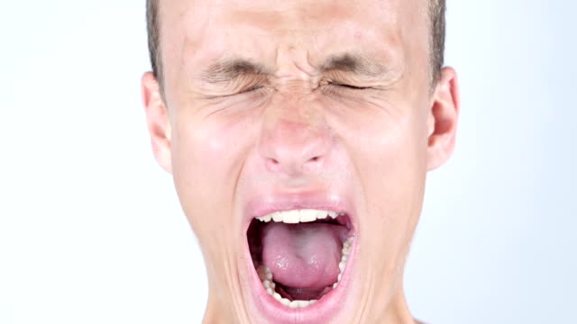 Close-up portrait of Angry ,upset ,depressesd ,young man screaming video