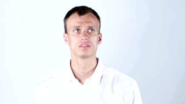 Closeup portrait of confused clueless young man video
