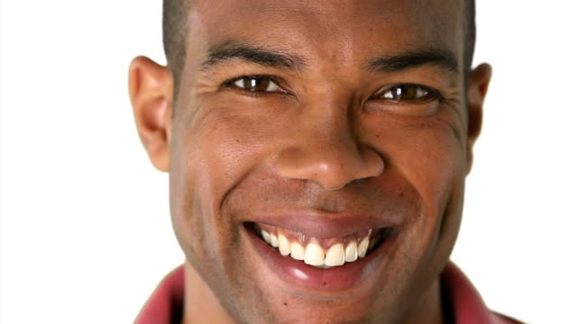 Closeup portrait of smiling African American man's face video