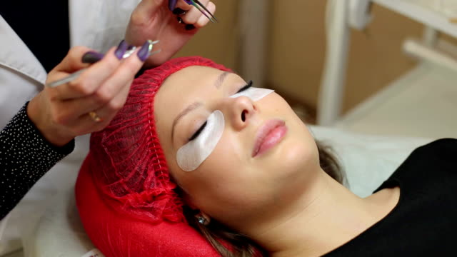 Close-up process of eyelash extensions. video