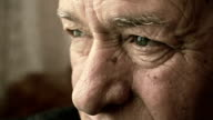 closeup sad and pensive old man's eyes: worried and afraid old man video