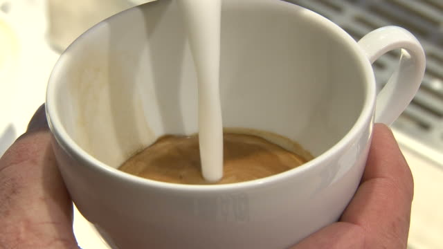 Close-up shot coffee cup being made by barista video