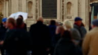 Closeup shot of a cross-generation crowd crossing the Millennium Bridge in London, England, Uk video