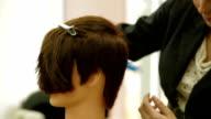 Close-up shot Of A Woman Making Haircut video