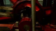 Closeup shot of an old industrial steam engine in motion video