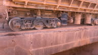 Close-up shot of dump car unloading ore at the crushing and sorting complex. Production of aluminum. Extraction of primary raw materials. video