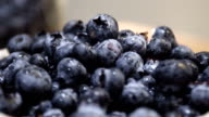 Closeup shot of fresh blueberries in a brown bowl at brunch video