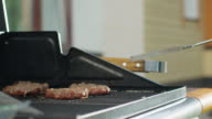 Close-up Shot of Man Flipping Burgers on Grill video