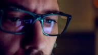 Close-up shot of man wearing glasses browsing the internet video