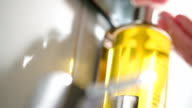 Close-up shot of pushing a container with liquid soap video