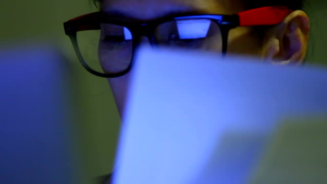 Closeup shot of woman in glasses surfing internet at night:1920x1080 FULL HD video