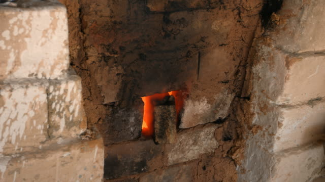 4K close-up shot that A flame and smoke is coming out of a porcelain kiln brick. video