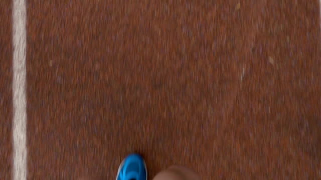 Close-up slow motion pov of a sportsman feet running on a course track video