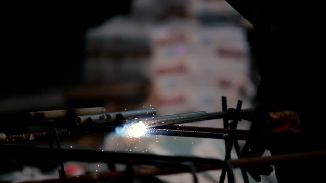 Close-up: the man welding the pipe video
