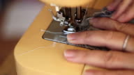 Close-up The tailor sewing on the sewing machine video
