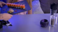 Close-up - the waiter put the sushi on board on the table in restaurant video