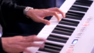 Close-up Two hands playing a on a piano video