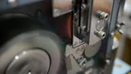 close-up: using grinder to cut plastic extrude to form plastic pellet video