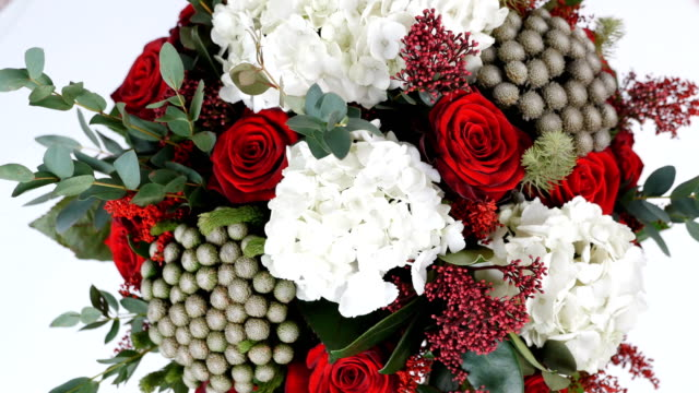 close-up, view from above, Flower bouquet, rotation on white background, floral composition consists of hydrangea, Rose, Brunia green, eucalyptus, Eustoma, solidago video