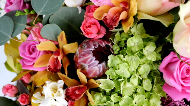 close-up, view from above, Flowers, bouquet, rotation, floral composition consists of Rose aqua, Ornithogalum, Brunia green, eucalyptus, Cymbidium orchid, Protea, Barbatus video