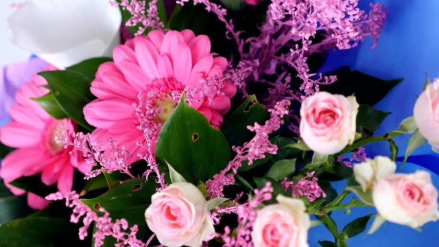 close-up, view from above, Flowers, bouquet, rotation on white background, floral composition consists of pink gerbera, Protea, calla, Rose yana creamy, solidago Russus video