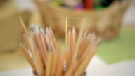 Close-up view of pot with pencils for drawing video