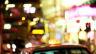 Closeup view of taxi on the street at evening in Hong Kong. video