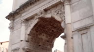 Close-up view of the Arch of Titus in Rome, Italy. Camera moving up video