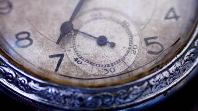 Closeup vintage clock face ticking off seconds video