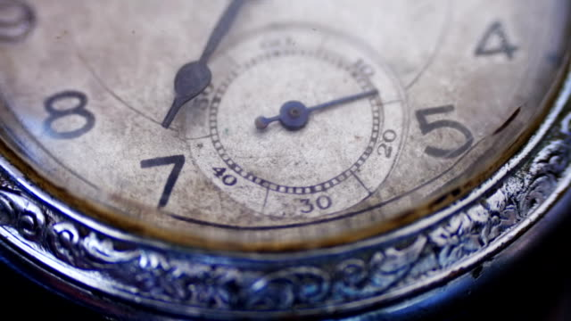 Closeup vintage clock face ticking off seconds video