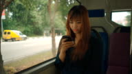 Close-up woman using smartphone on bus video