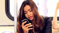 Close-up woman using smartphone on train video