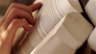 Closeup. Womans hand turns the page in a favorite book video