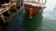 Close-up wood boat moored at boats wharf, Venice, Italy video