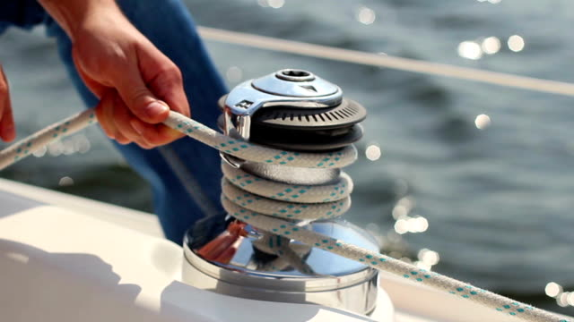 Closeup yachtsman tying sail ropes, sailing, yachting, sport video