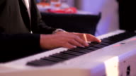 Close-up:Man plays the piano chord video