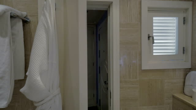 Closing bathroom door in the hotel video