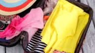 Clothes fills suitcase. video
