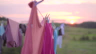 Clothing drying in the wind on sunset video