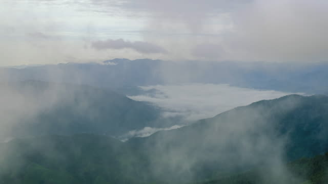 cloud and foggy on morning over mountain and small village video