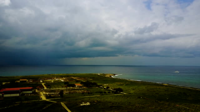 cloud landscape in a resort town. Cottages, sea, vacation, mountains Cyprus. Paphos. moody seascape before the storm. video